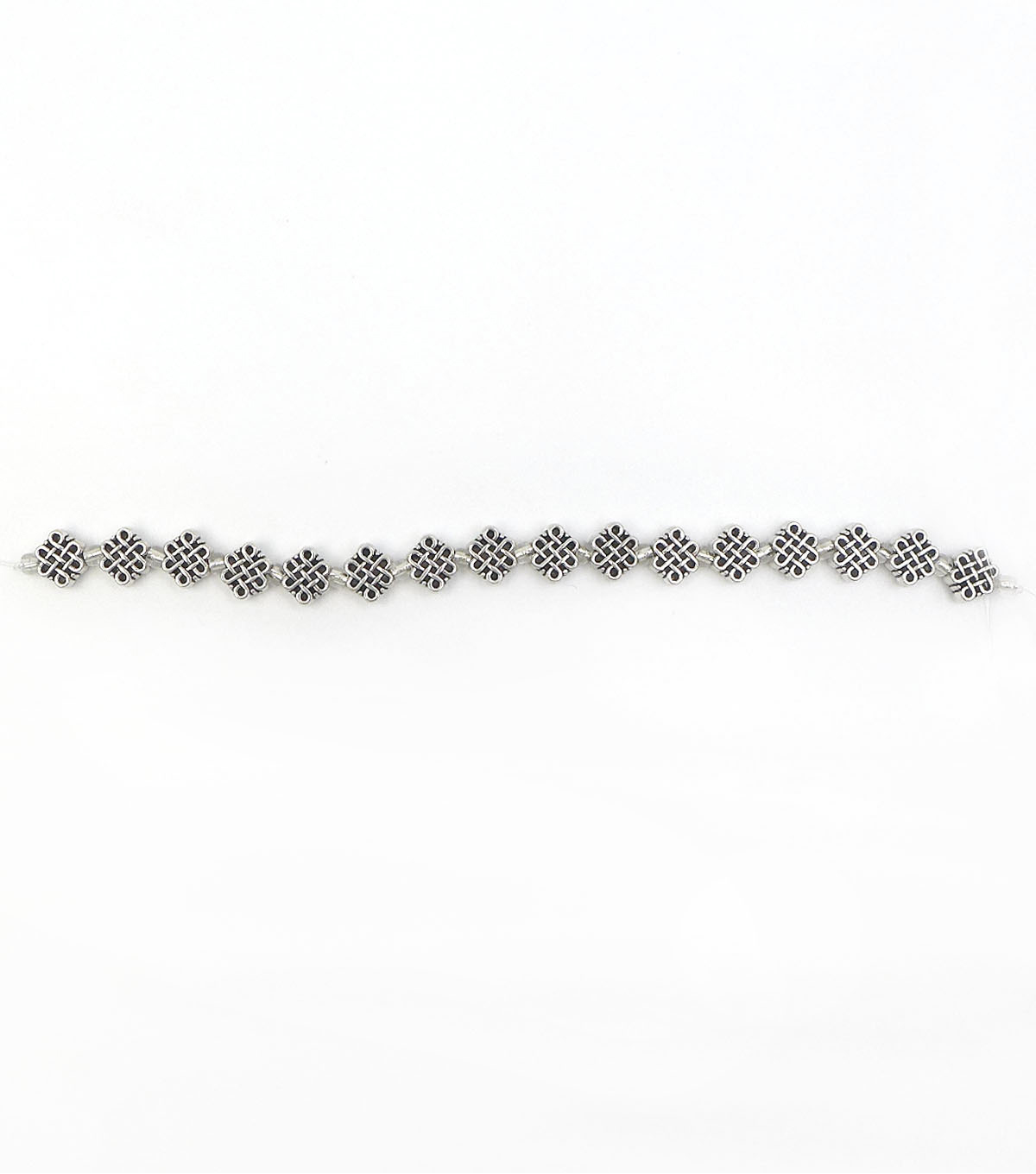 hildie & jo™ Knot Metal Strung Beads