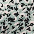 Apparel Knit Fabric 57\u0027\u0027-White & Black Tossed Mini Floral on Green