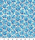 Quilter\u0027s Showcase Cotton Fabric -Multi Blue Floral Bursts on White