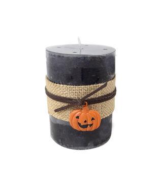 Maker's Halloween 3''x4'' Black Pillar Candle with Jack-o'-lantern Charm