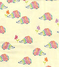 Snuggle Flannel Fabric -Rainbow Hedgehogs On Cream