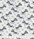 Snuggle Flannel Fabric-Running Zebra Tossed