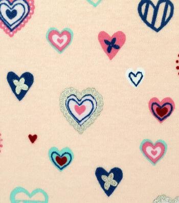 Doodles Juvenile Apparel Fabric -Foiled Hippie Hearts Interlock