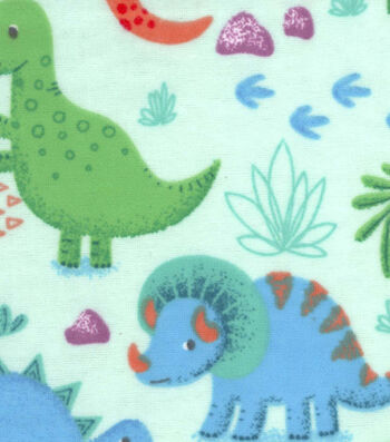 Snuggle Flannel Fabric -Happy Dinos On Green