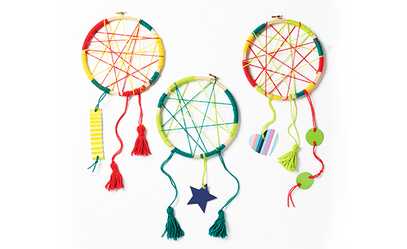 Image of 3 dream catchers, crafted from yarn.