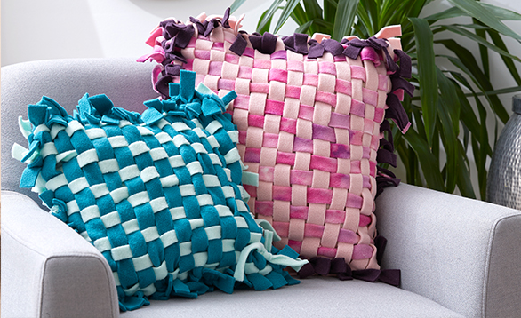 image of woven pillows on a lounge chair.