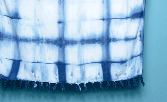 Image of tie dyed summer beach towel.