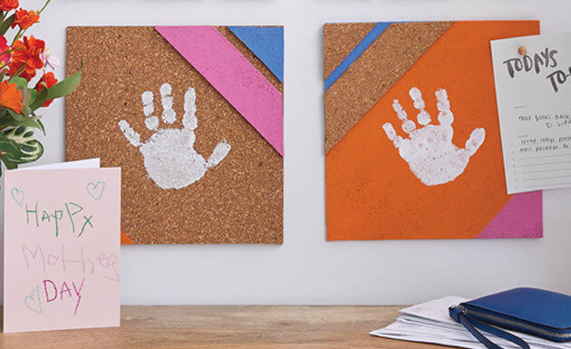 image of corkboard handprints with cards for mom.
