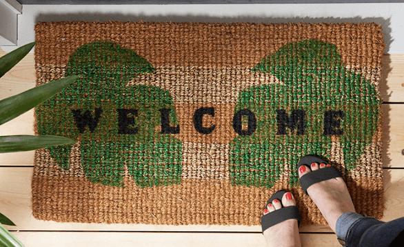 Image of door mat that has palm trees on it.