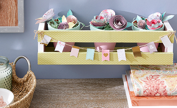 image of wall shelf with paper flowers inside.