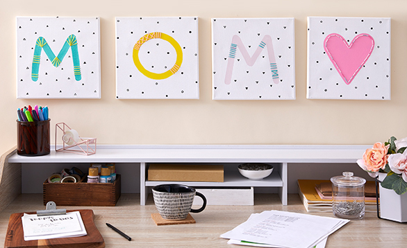 image of canvas art spelling out MOM with a pink heart.