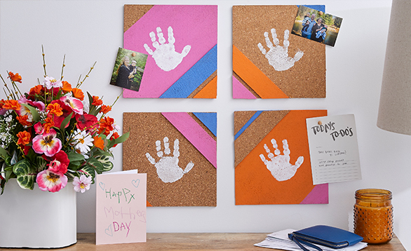image of handprints on a corkboard.