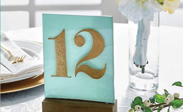 Image of  table numbers at a baby showers.