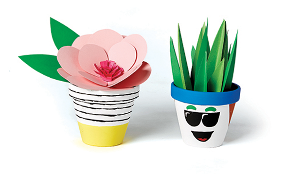 Image of kids paper crafts, flower pot and cactus made of paper.