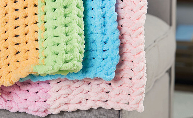 Image of pastel baby blankets created with big twist loop yarn.