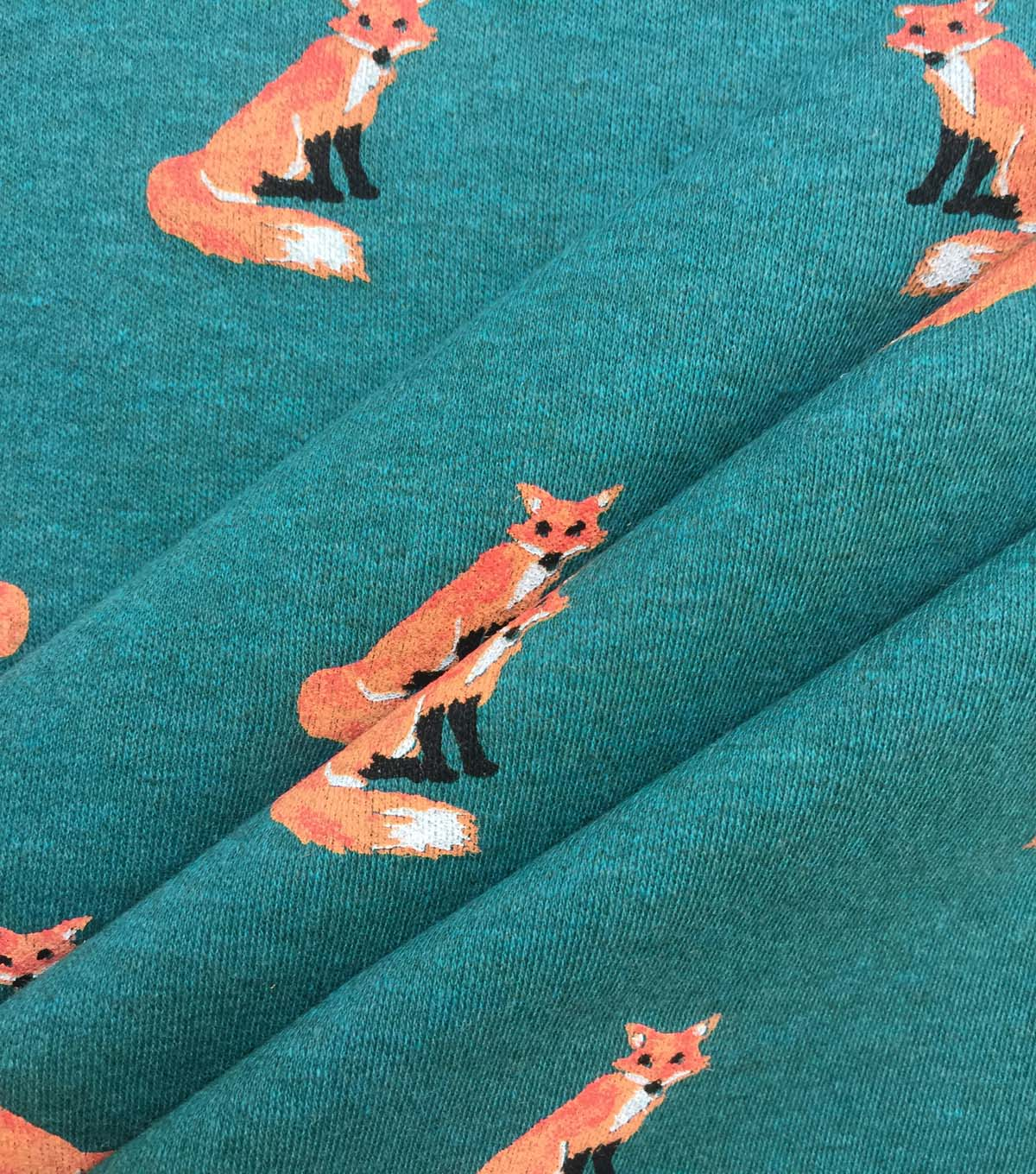 Doodles Juvenile Apparel Fabric-Sitting Foxes on Green
