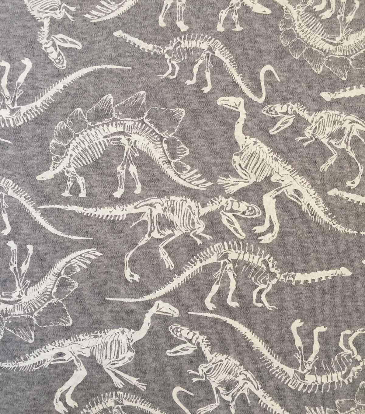 Doodles Cotton Interlock Knit Fabric-Heather Gray Dino Skeletons