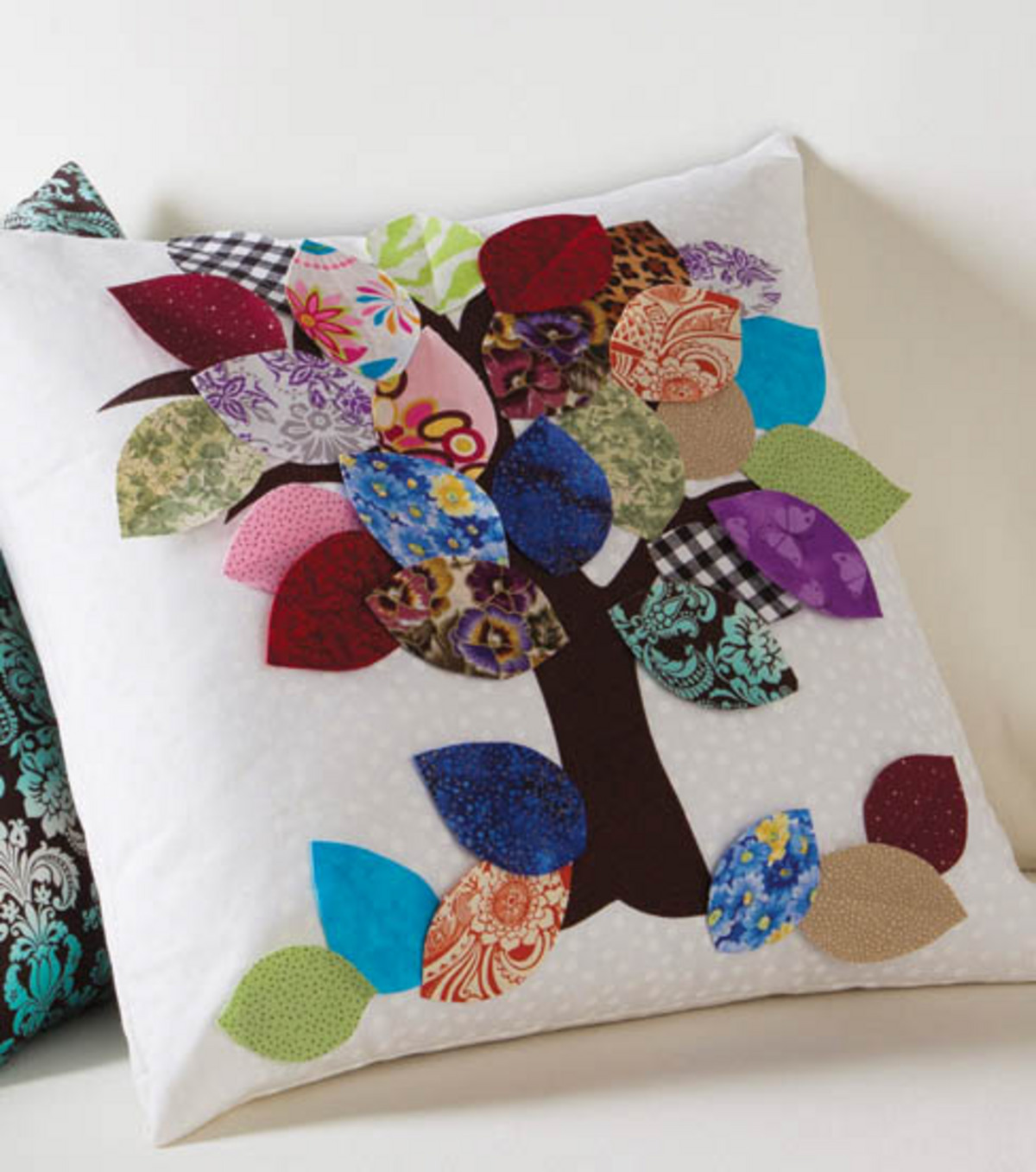 Pillow with tree and leaves